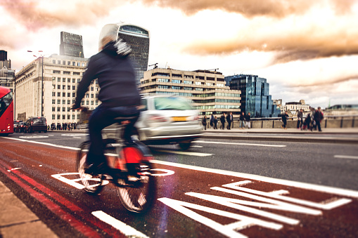 Bike lane in London with a cyclist in the traffic, UK