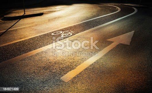 667005568istockphoto Bike lane in the fall evening 184921499