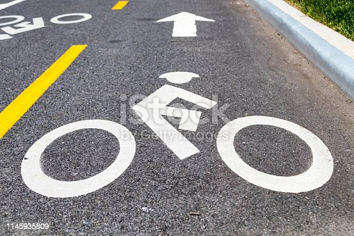 Bike lane safety symbol painted on the street in New York City NYC