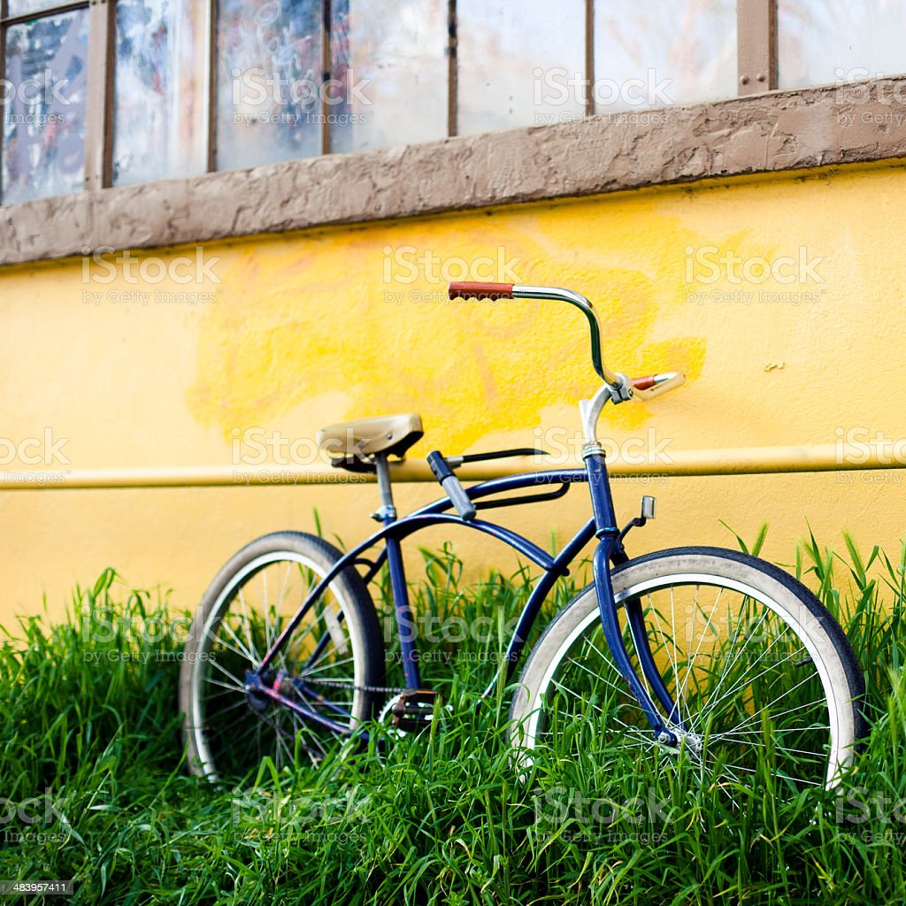 Bike leaning against wall stock photo