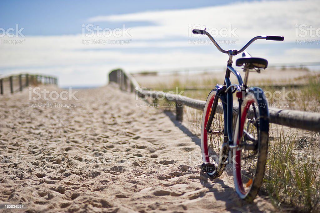 bike left at the beach stock photo