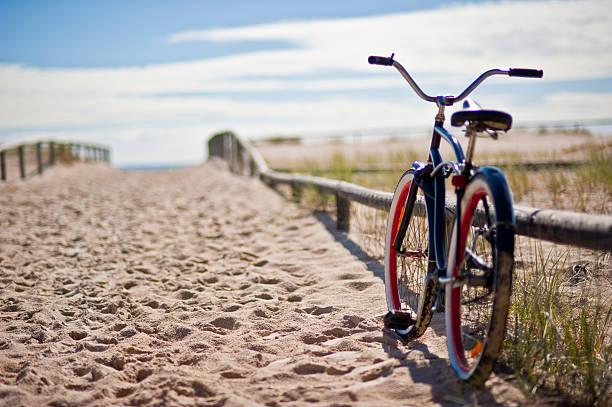 bike left at the beach stock photo