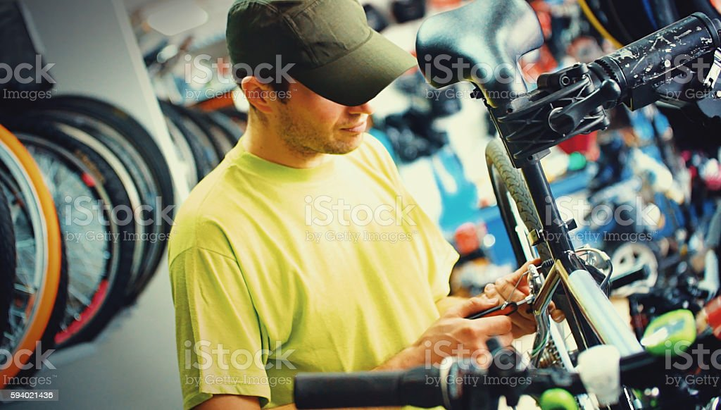 Bike mechanic at work. stock photo