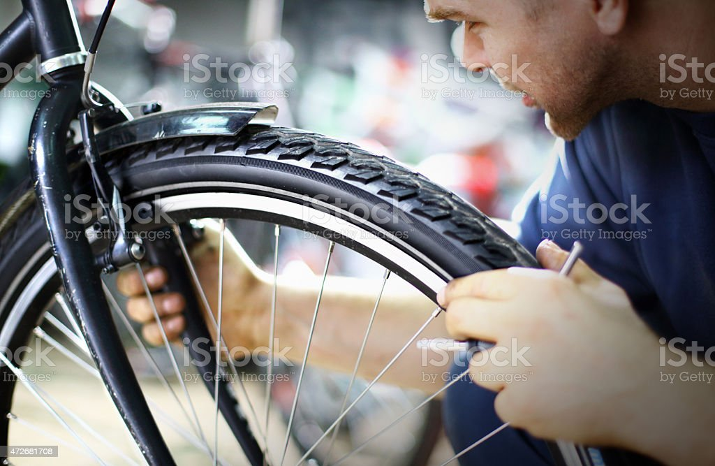 Bike mechanic repairing a wheel stock photo