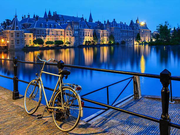 bike on canal, the hague - den haag stockfoto's en -beelden