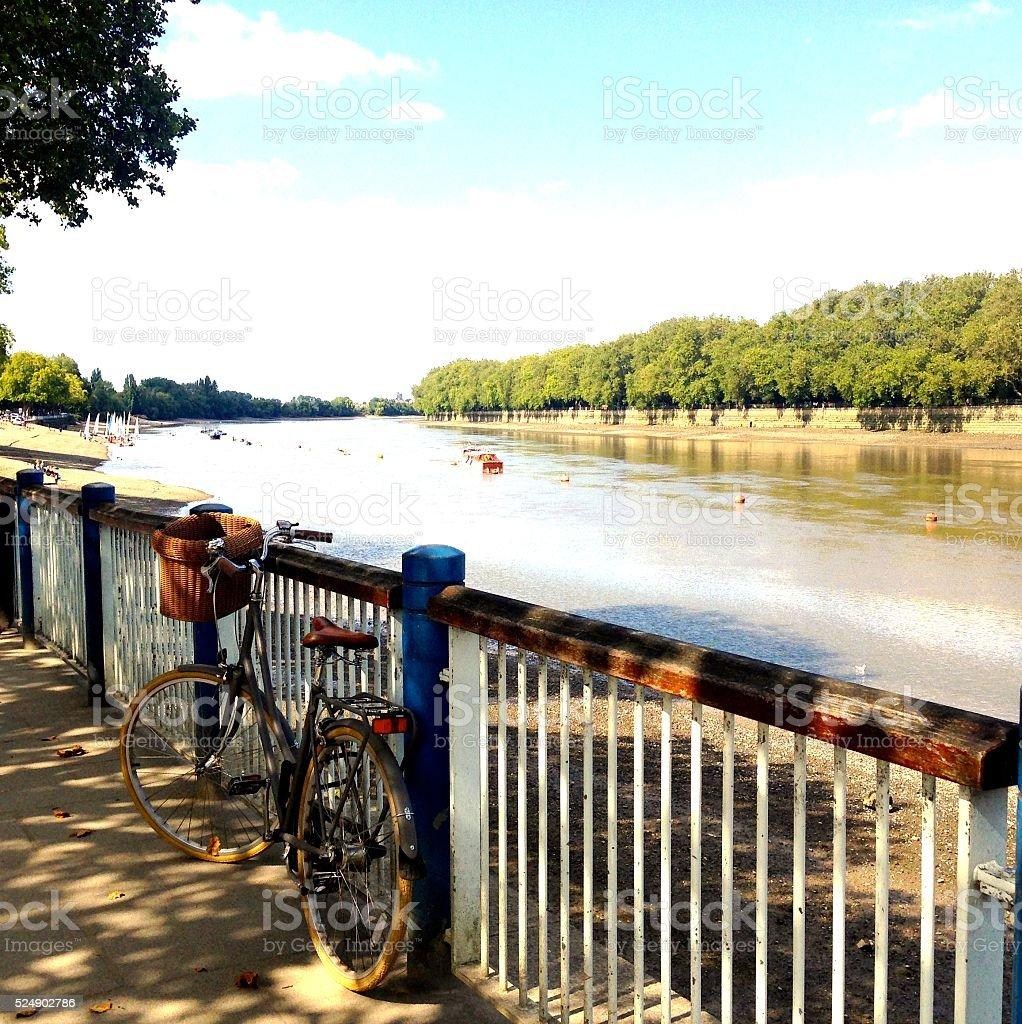 bike on the riverside stock photo