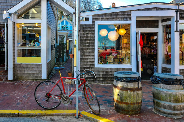 Bike on the street Bike in front of Provincetown shops provincetown stock pictures, royalty-free photos & images