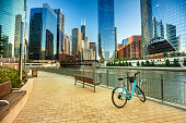 The downtown urban city view along the Riverwalk path on the Chicago River in Illinois USA