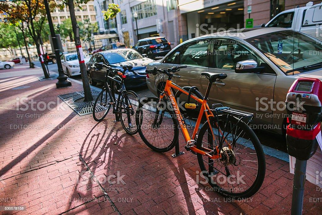 Bike parked on street. stock photo