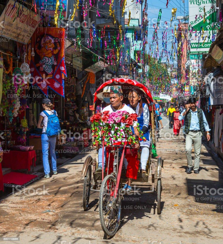 Bike Rickshaw carry Passengers in tiny Street of Kathmandu City stock photo