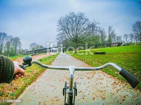 First person photos during a bike ride in the park of Amsterdam