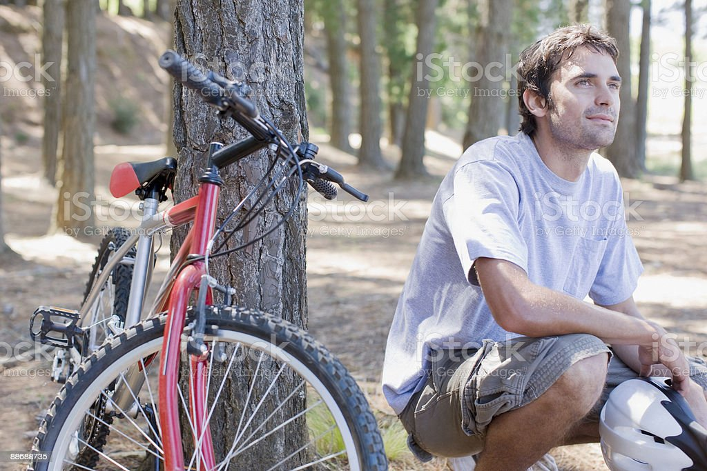Bike rider relaxing in forest royalty-free stock photo