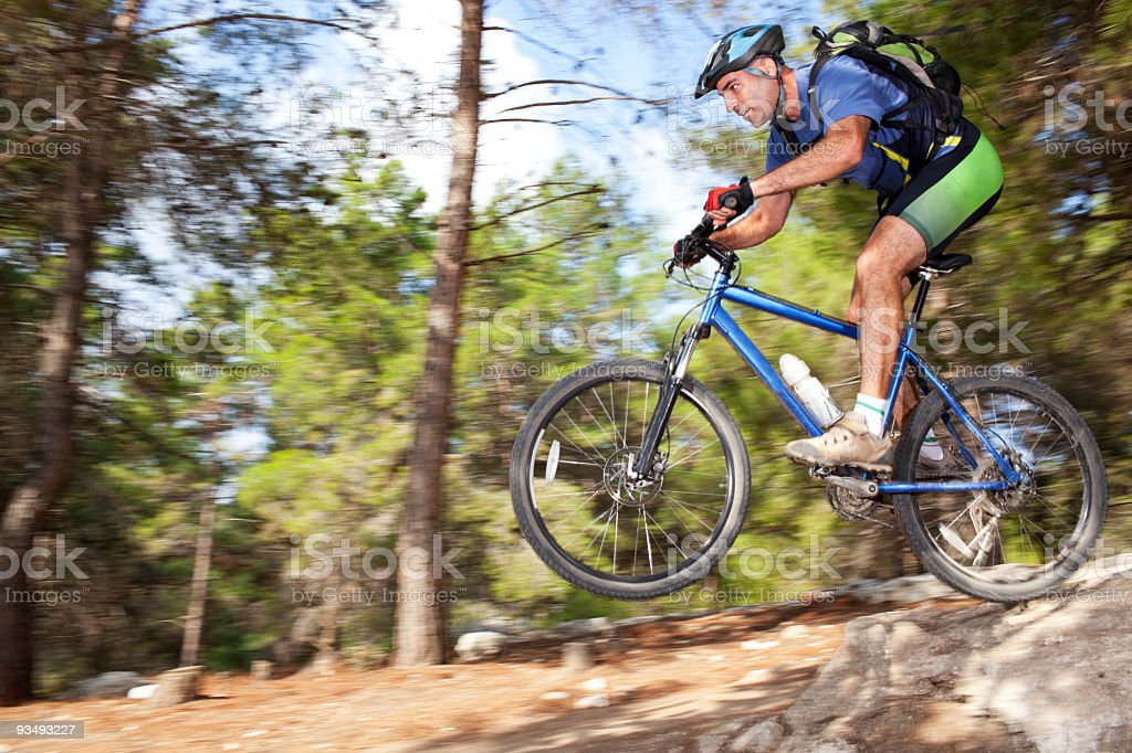 Bike riding in forest. royalty-free stock photo