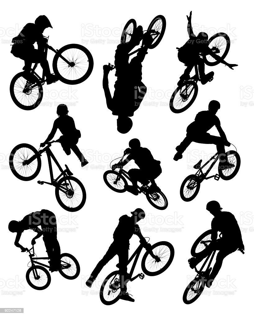 Bike stunt silhouettes stock photo