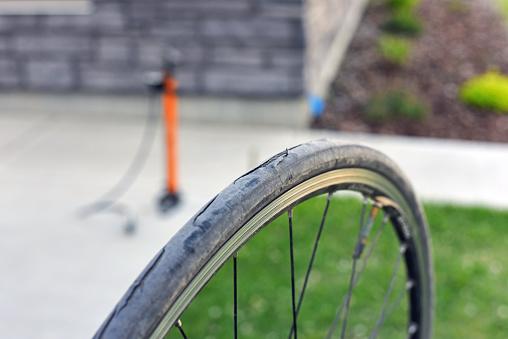 Bike Tire Shredded With Hand Pump - zdjęcia stockowe i więcej obrazów Bicykl