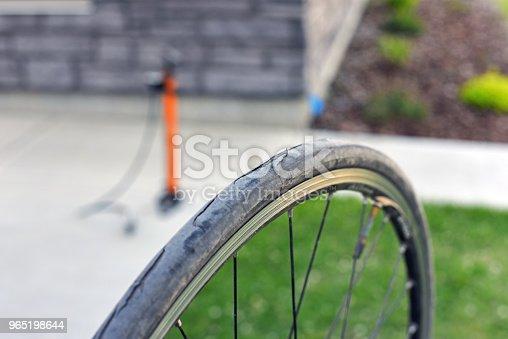 Bike Tire Shredded With Hand Pump - Stockowe zdjęcia i więcej obrazów Bicykl