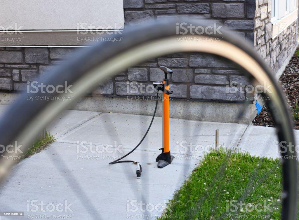 Bike tire shredded with hand pump zbiór zdjęć royalty-free