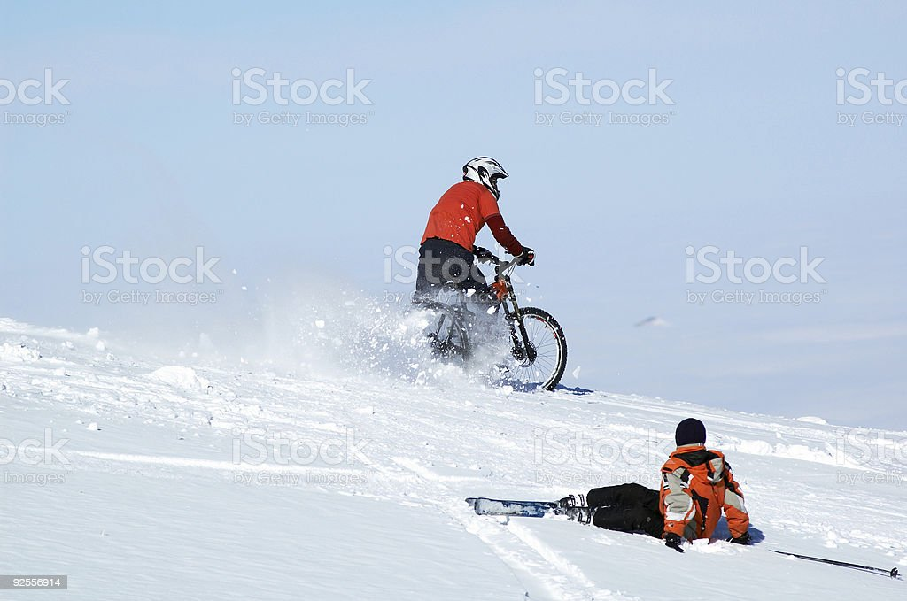 Biker and fall skier stock photo