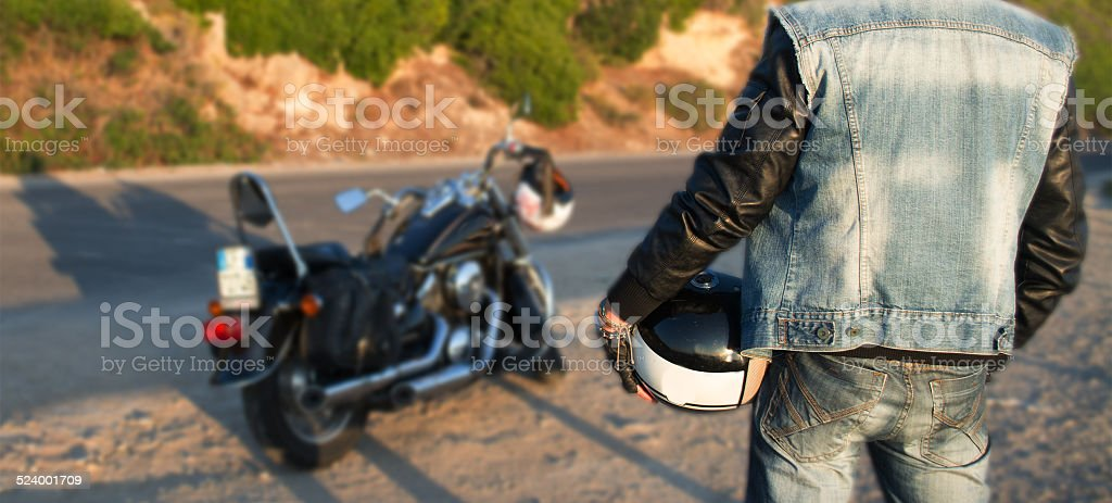 biker and motorcycle on the road stock photo