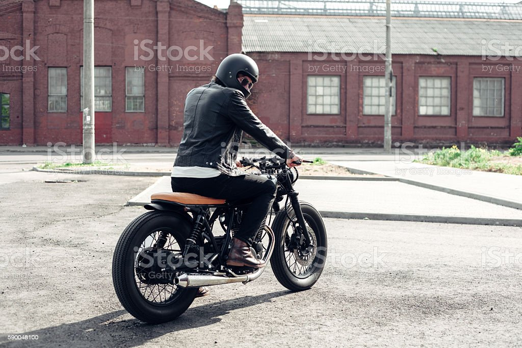 Biker and vintage custom motorcycle stock photo