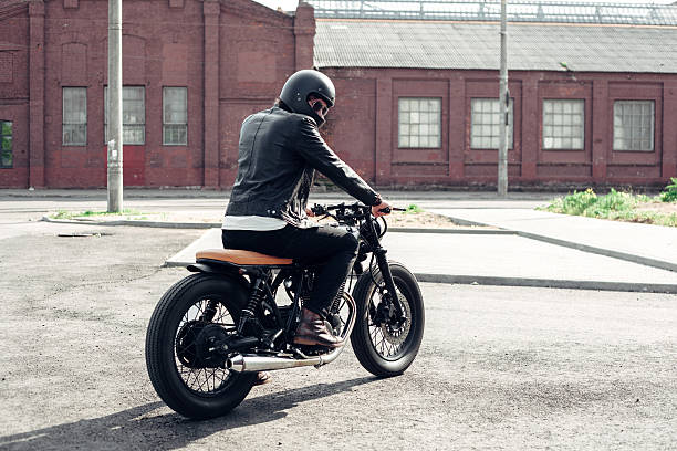 Biker and vintage custom motorcycle stock photo