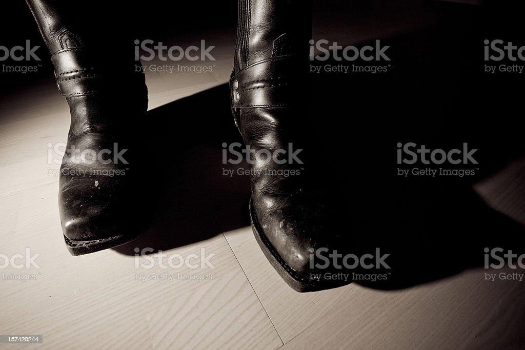 Biker boots sepia stock photo