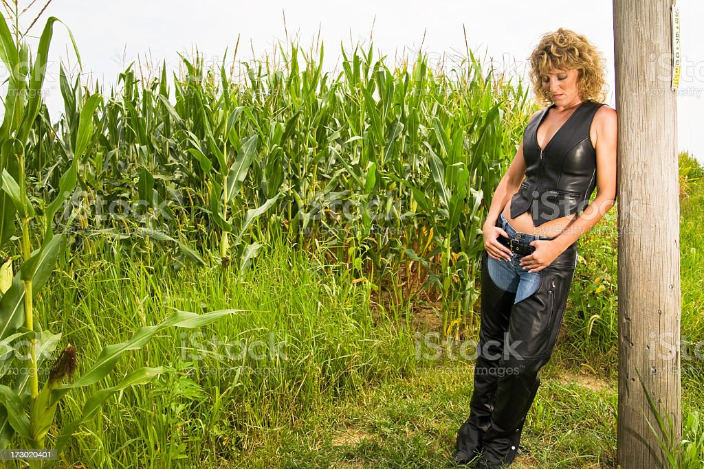 Biker Chick on Side of Road stock photo