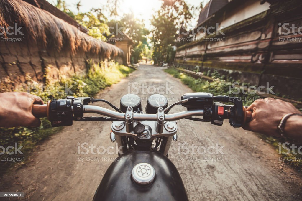 Biker driving his motorcycle on country road stock photo