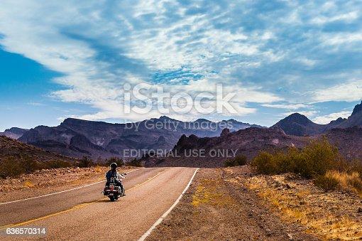 Oatman, Arizona, USA - September 10, 2015: Biker driving on the Highway on legendary Route 66 to Oatman, Arizona.
