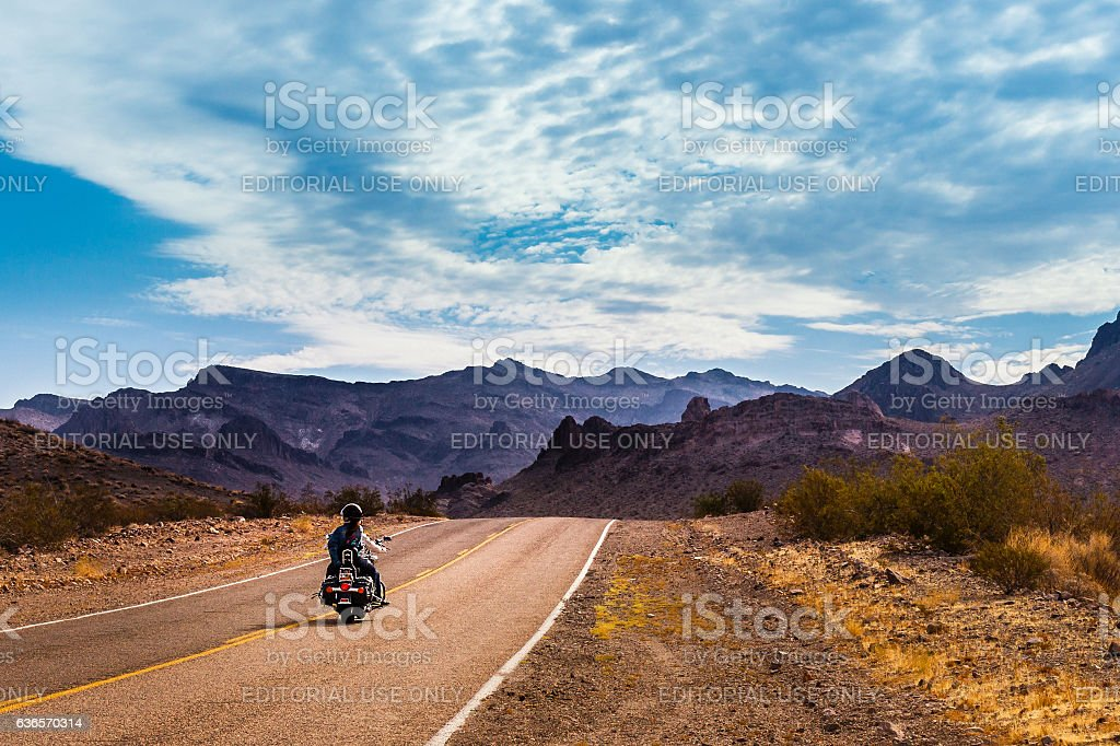 Biker driving on on legendary Route 66 to Oatman, Arizona. stock photo