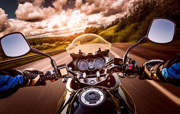biker first-person view - motorcycle stock photos and pictures