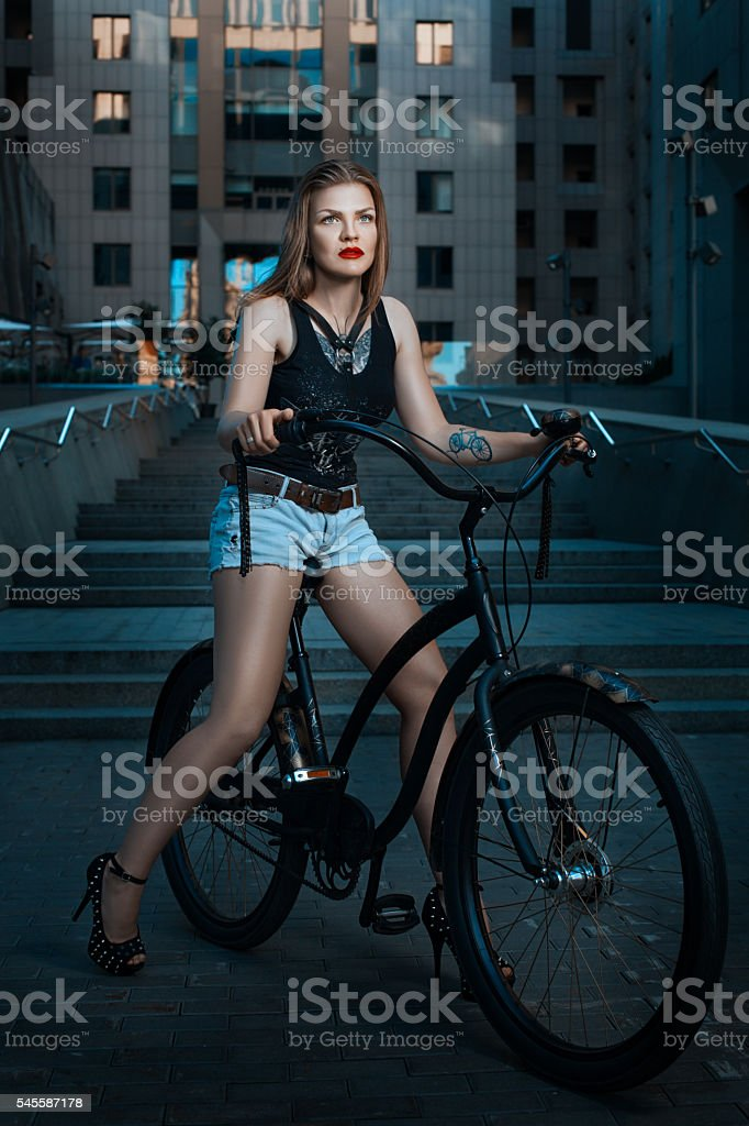 Biker girl on a bicycle. stock photo