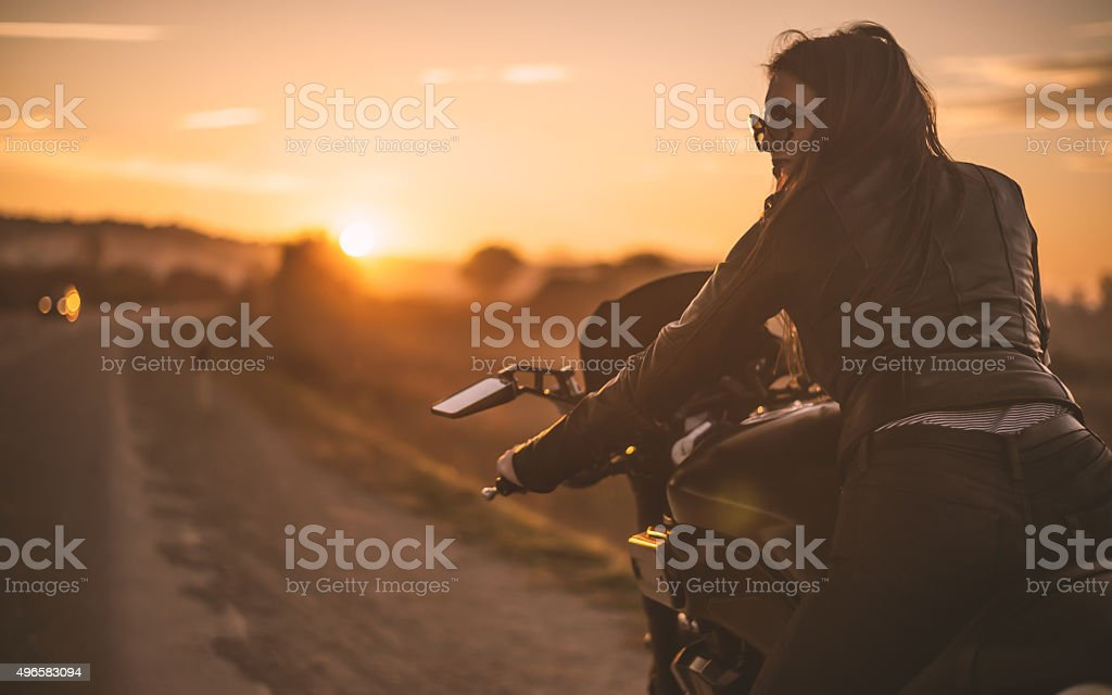 Biker girl on the road stock photo