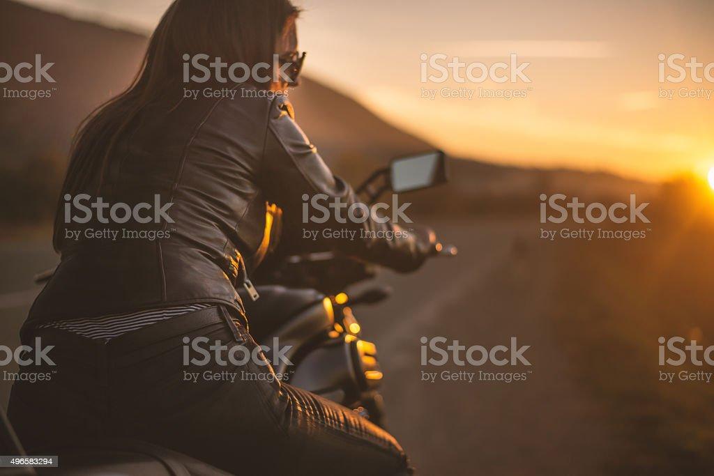 Biker girl on the road stock photo