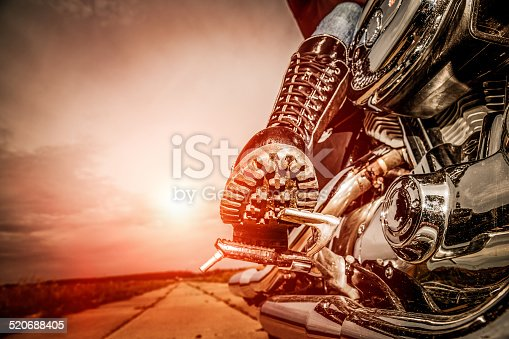 istock Biker girl riding on a motorcycle 520688405
