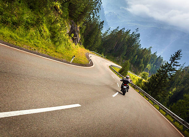 biker in austrian mountains - motorcycle stock photos and pictures