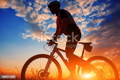 istock biker in autumn on a sunny afternoon 506041092