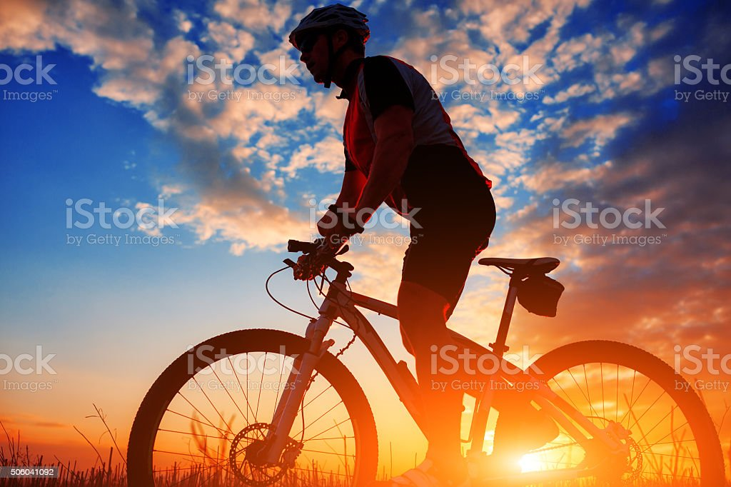biker in autumn on a sunny afternoon stock photo