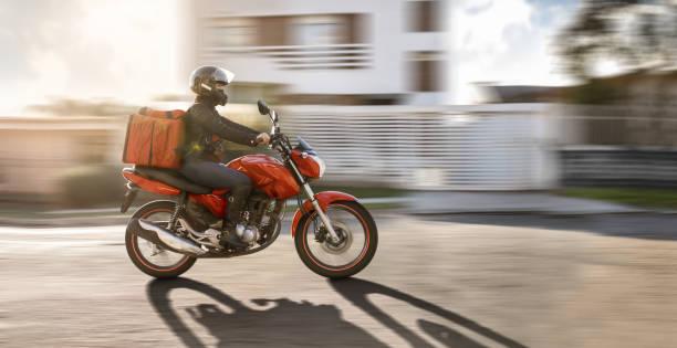 Biker in motion- Motogirl, Motoboy stock photo