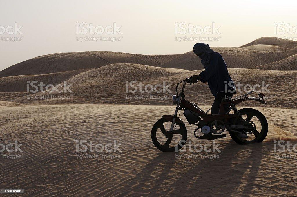 Biker in the desert royalty-free stock photo