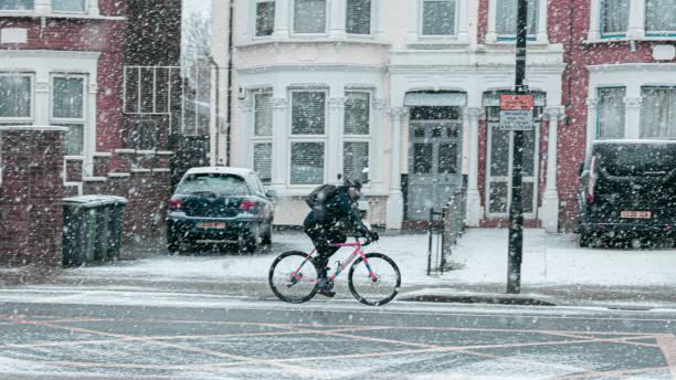 Biker in the snow. North London stock photo