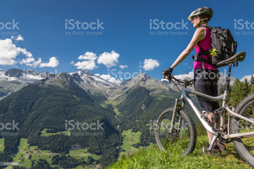 Biker looking over Aurina Valley, Italy royalty-free stock photo