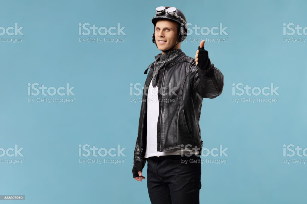 Biker making a thumb up gesture stock photo