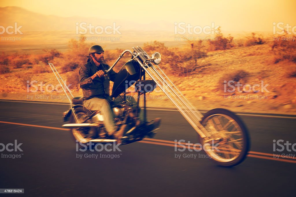 Biker on a Motorcycle in the Desert stock photo