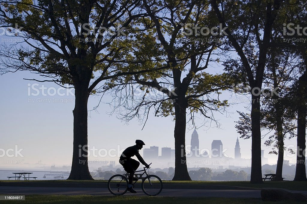 Biker on Foggy Morning Cleveland in Background stock photo