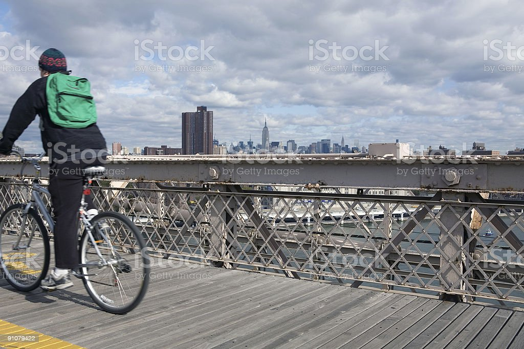 Biker on Manhattan Bridge royalty-free stock photo