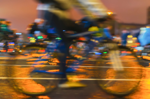 929609038 istock photo Biker on the bicycle, cyclist's foot on pedals close-up. Parade of bicyclists in city, night light, bokeh. Sport, healthy lifestyle concept. Abstract blurred background 948683458