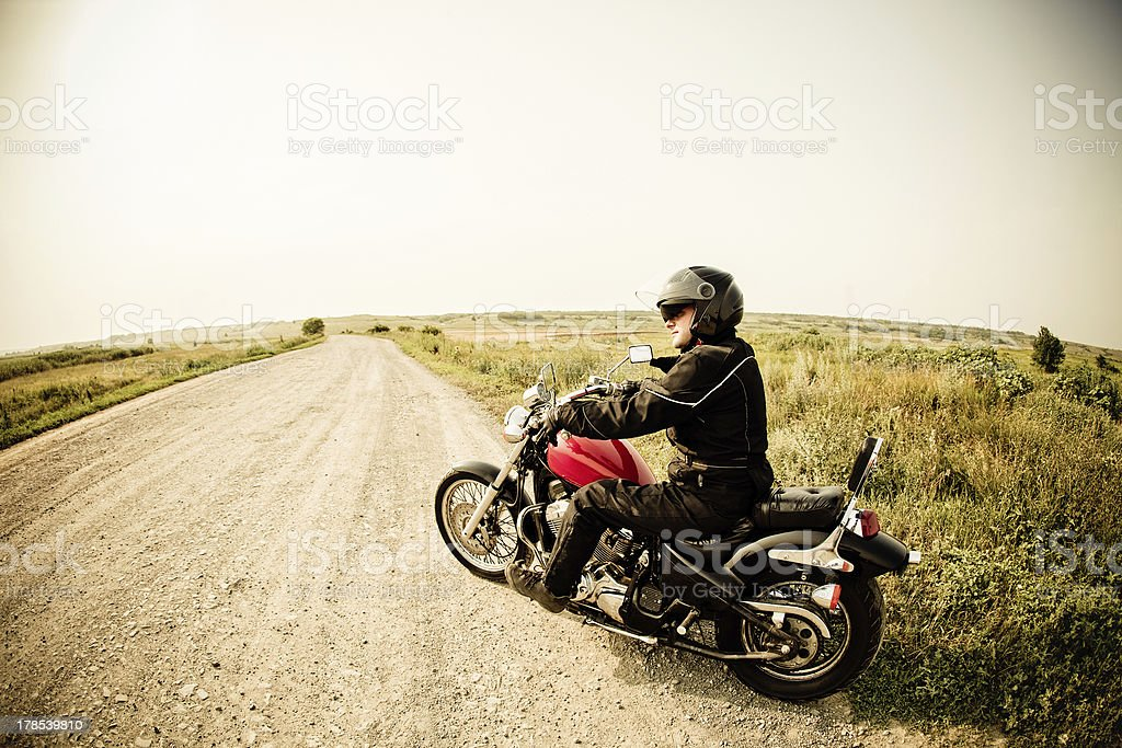 Biker on the country road stock photo