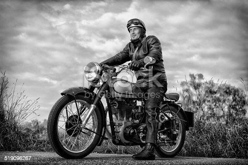 istock biker on vintage motorcycle 519096267