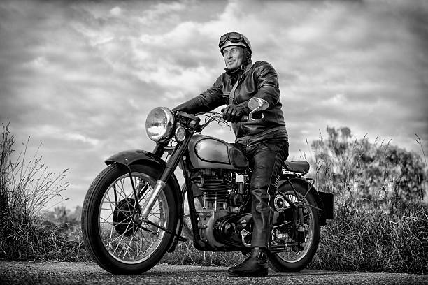 biker on vintage motorcycle - biker stock photos and pictures